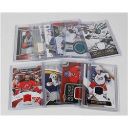 10 ASSORTED HOCKEY & BASKETBALL JERSEY CARDS