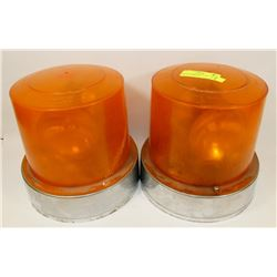 LOT OF 2 AMBER ROTATING LIGHTS, ONE HAS CRACK IN