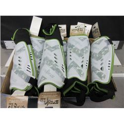 7 New pairs of Striker Soccer Shin Guards / ages 6-12