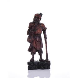 Wood Carved Sculpture Of A Traveling Man