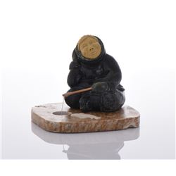 Inuit Stone Carved Fisherman Sculpture.