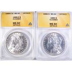 1880-O & 86 MORGAN DOLLARS ANACS MS-60 BU CLEANED