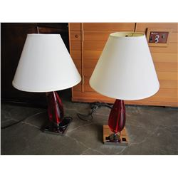 PAIR OF MODERN RED GLASS AND CHROME TABLE LAMPS WITH OUTLETS