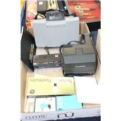 Box of Vintage Cameras (2 Polaroid & 1 Kodak) and Pkgs. of Flashbulbs