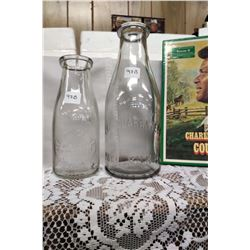 1 Qt. 'The Guaranteed Pure Milk Co.' Bottle and 'Alberta Central Creamery' Bottle - Both Turning Pur