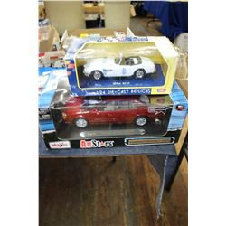 Die Cast Cadillac DeVille (1:18 Scale) & Motor Max Die Cast BMW (1:14 Scale)