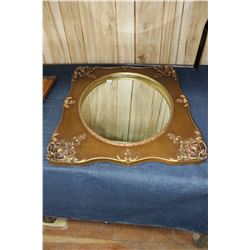 Oval Mirror in an Ornate Frame
