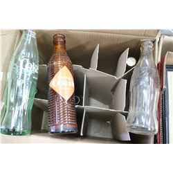 Box w/Collector Bottles - 4 Coca Cola (1 turning green); a Pioneer Syrup Bottle; a Calgary Pop Bottl