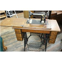 Singer Treadle Sewing Machine w/Bullet Bobbin; Wooden Cabinet w/6 Drawers (incl. contents) & Attachm