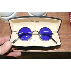 Pair of Glasses with Blue Circular Lenses