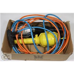 BOX WITH WORK LIGHTS AND EXTENSION CORD.