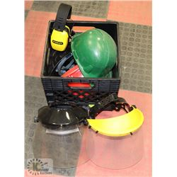 CRATE WITH FACE SHIELDS AND HARD HATS.