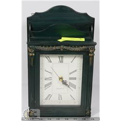 QUARTZ CLOCK WITH HIDDEN KEY CABINET