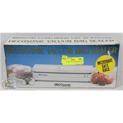 DECOSONIC VACUUM BAG SEALER.