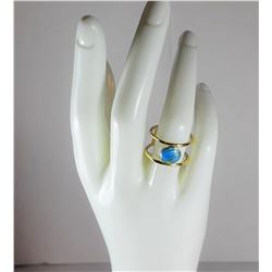11)  GOLD TONE BEZEL SET TURQUOISE RING