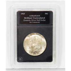 1965 ENCASED US KENNEDY SILVER HALF DOLLAR COIN.