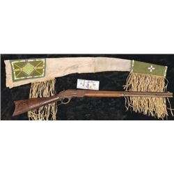 Winchester 1873 38.40 octagon barrel rifle with great beaded scabbard