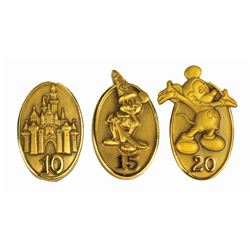 Set of (3) Cast Member Service Award Pins.