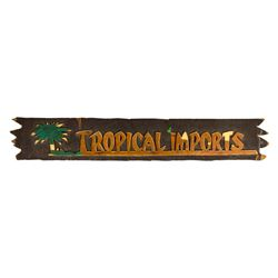 "Adventureland ""Tropical Imports"" Wooden Sign."