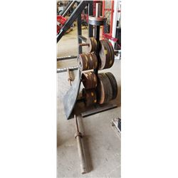 RACK OF ASSORTED WEIGHT PLATES W/ BARBELL