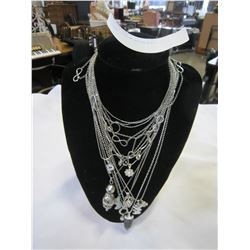 LOT OF CHAIN NECKLACES ON STAND