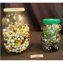 Two Large Jars Of Marbles
