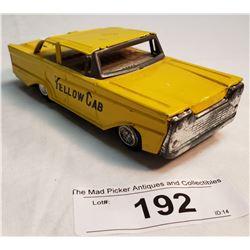 Vintage Yellow Cab Tin Taxi Toy