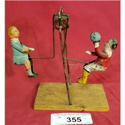 Antique Teeter Totter Tin Toy