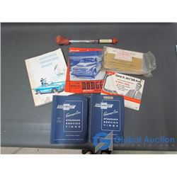 Assorted Car Manuals and Glass Antifreeze Tester
