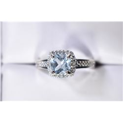 SKY BLUE TOPAZ AND DIAMOND HALO STYLE RING IN