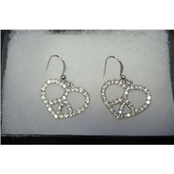 Peace sign combined with a romatic heart outlined in swarovski crystals on silver hooks compose thes