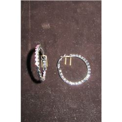 Silver textured hoop earrings accented with aurora borealis swarovski crystals