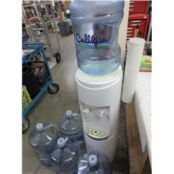 Water Cooler & 5 empty Jugs / each jug has $10.00 refund on them / also