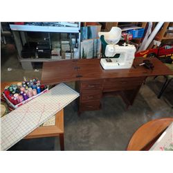 KENMORE SEWING MACHINE W/ ELEVATOR TABLE AND BOX OF THREAD AND CUTTING CHART
