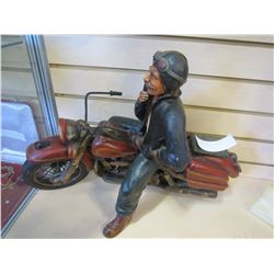 MAN ON MOTORCYCLE STATUE