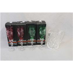 """Signed Waterford crystal 6 1/2"""" water jug and four Nachtmann cut crystal champagne flutes including"""