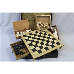 Vintage black lacquered Asian box housing footed wooden chess board with chess pieces, and two ebony