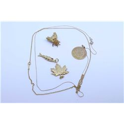 """Selection of yellow gold jewellery including a fine 16"""" 10kt chain, an 18"""" 10kt chain a 14kt Expo 67"""