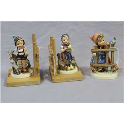 """Pair of vintage Goebel Hummel figural bookends and """"Signs of Spring"""" figurine with full bee markings"""