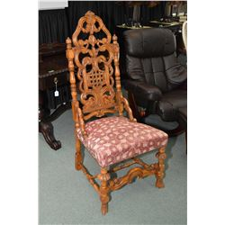 Antique heavily carved throne with upholstered seat