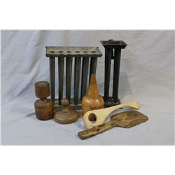 Selection of primitive collectibles including tapered candle moulds, butter mould, coloured, wooden