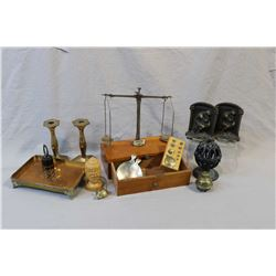 Selection of collectibles including gold scale with weights, a set of cast Rodan inspired bookends,