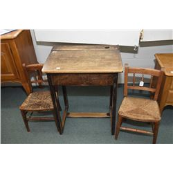 Two child sized rush seat antique chairs and a flip up student desk with ink well, missing liner
