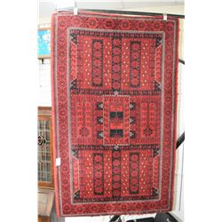 100% wool area carpet with overall geometric design, red and black with highlights of taupe and whit