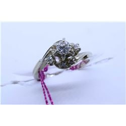 14kt white gold solitaire diamond ring with small diamond accents