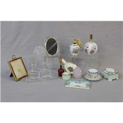 Selection of vintage dresser pieces including perfumes, small frames, lidded trinket boxes etc.