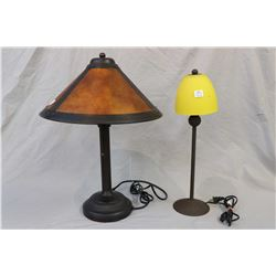Two bronze coloured table lamps including one with dual bulbs and a small lamp with glass shades