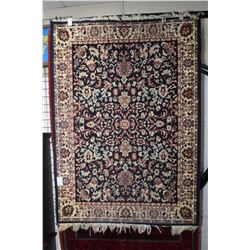 Wool area carpet with floral design, blue background and teal, taupe, cream and red colours etc. 47""