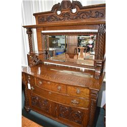 Antique quarter cut oak sideboard with curved drawers, two doors with applied carvings, tall mirrore
