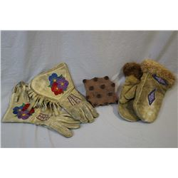 Pair of embroidered tasselled gauntlets, a pair of glass beaded fur edged mittens and a wooden texti